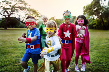 58318992 - superheroes kids friends playing togetherness fun concept